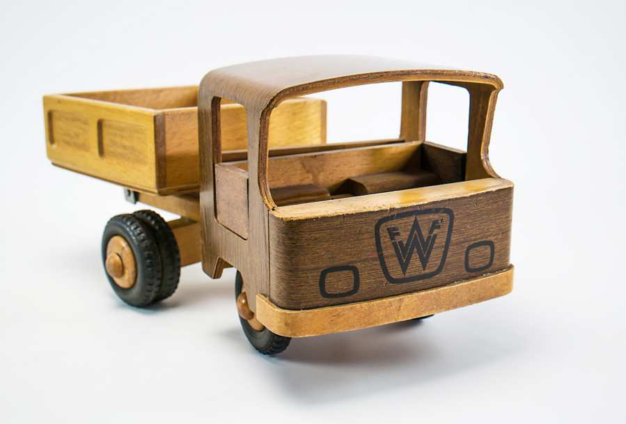 Wooden toy truck with mounted crane