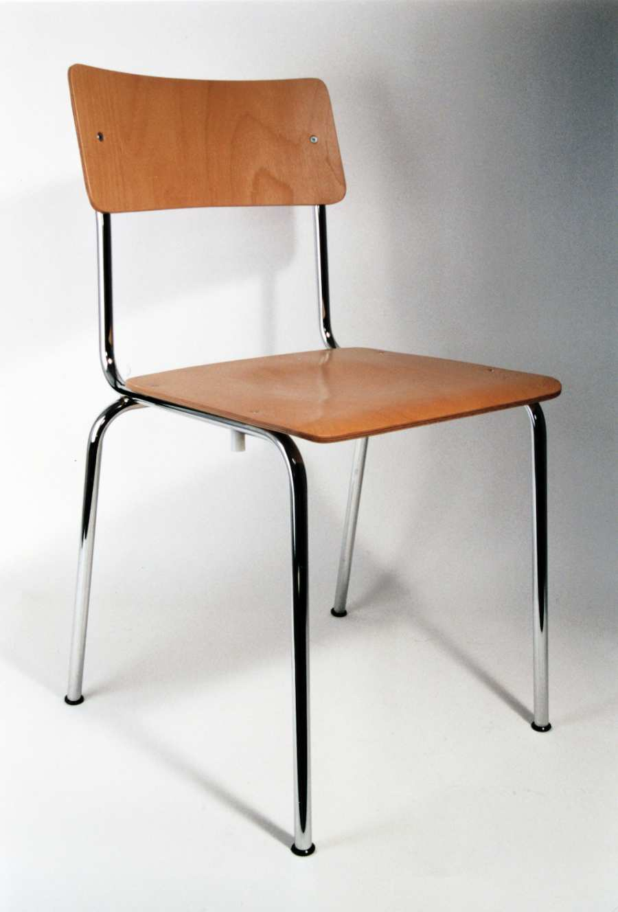Stacking chair Stendal COMEBACK made timber and black metal frame